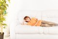 Resting at home on sofa one happy smiling relaxed boy years old laying the coach Royalty Free Stock Photography