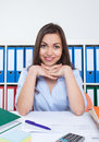 Resting secretary with long dark hair at office Royalty Free Stock Photo