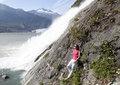 Resting by the waterfall girl next to mendenhall glacier nugget juneau alaska Stock Image