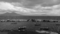 Restless Bay of Naples overlooking the Vesuvius and the beautiful boats in the foreground. Black and white Royalty Free Stock Photo