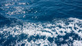 Restless foamy blue sea water from above Royalty Free Stock Images