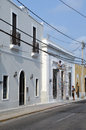Restoration of historic building man in scaffold painting exterior restored in mexico Stock Photography