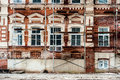 Restoration of old building with white windows and red blocks Stock Image