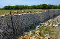Restore drywall with stones wall in focus in the countryside of apulia Stock Photos