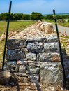 Restore drywall with stones wall in focus in the countryside of apulia Royalty Free Stock Photography