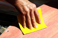 Restore an old skateboard with a yellow sandpaper Royalty Free Stock Photos