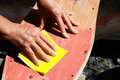 Restore an old skateboard with a yellow sandpaper Stock Images