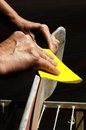 Restore an old skateboard with a yellow sandpaper Stock Image