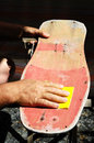 Restore an old skateboard with a yellow sandpaper Royalty Free Stock Photo