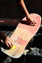 Restore an old skateboard with a yellow sandpaper Stock Photos