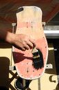 Restore an old vintage skateboard with black painting Stock Photos