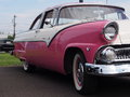 Restored antique pink and white ford Royalty Free Stock Photography