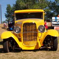 Restored classic yellow street rod with headlamps Royalty Free Stock Photography