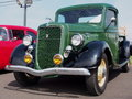 Restored green and black antique ford delivery truck Stock Photography