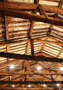 Restored roof with wooden beams and the lamps Royalty Free Stock Photo