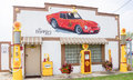 Restored route garage at dwight jpg landmark with old shell pumps pennzoil oil pump and ferrari mural on facade on august Royalty Free Stock Photos