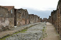 Restored street in the ancient city pompeii paved is recovered middle of roman ruins has been a popular tourist destination for Stock Images