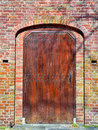 Restored wooden medieval door of church in bright day Royalty Free Stock Photography