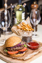 Restourant serving dish - burger with cutlet with frying potato Royalty Free Stock Photo