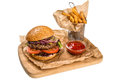 Restourant serving dish burger with meat frying potato on woo wooden board Stock Images