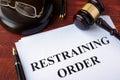 Restraining order and gavel. Royalty Free Stock Photo