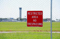 Restricted area no trespassing sign at airport Royalty Free Stock Photo