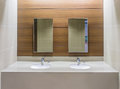 Restroom interior mirrors and washbasins in Stock Photography