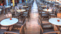 Resturant tables and chairs in hotel Stock Images