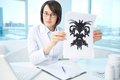 Results of test serious psychologist showing paper with rorschach inkblot Stock Image