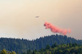 Retardant drop a tanker airplane drops its red load over the southern oregon coastal range mountains at the douglas complex forest Stock Photography
