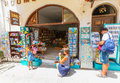 Rethymnon, Island Crete, Greece, - July 1, 2016: Family near the souvenir store `Book spot`. There are mother is taking photo wit Royalty Free Stock Photo