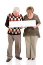 Retired couple banner holding white on white background Royalty Free Stock Photos
