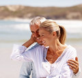 Retired couple enjoying at the beach Stock Photography