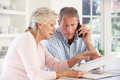 Retired couple with household bills Royalty Free Stock Image