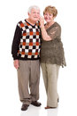 Retired couple mobile phone happy using on white background Royalty Free Stock Photography