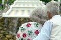 Retired couple outdoors back view of are embracing Royalty Free Stock Photography