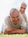 Retired couple in a playful mood outdoors Royalty Free Stock Image