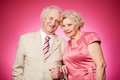 Retired couple portrait of a charming posing against pink background Stock Image