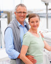 Retired couple posing on a sailboat Stock Image