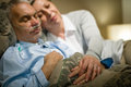 Retired ill man and caring wife sleeping men together holding hands Royalty Free Stock Images
