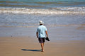 Retired man on the beach walks concept photo retirement Royalty Free Stock Images