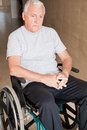 Retired man on wheelchair at hospital Stock Photo