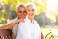 Retired mature couple relaxing outdoors Stock Photos
