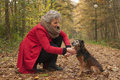 Retired woman is caring of her dog Stock Image