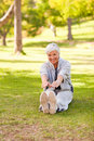Retired woman doing her stretches Stock Photo