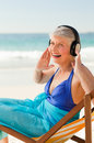 Retired woman listening to music Stock Photography