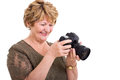 Retired woman slr camera cheerful senior viewing photos on a digital Stock Images
