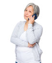 Retired woman talk to cellphone Royalty Free Stock Photo