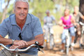 Retiree having a bike ride with friends Royalty Free Stock Photography