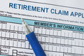 Retirement claim application form with blue pen Royalty Free Stock Images